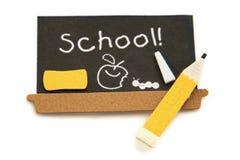 Placa preta da escola com lápis Fotografia de Stock Royalty Free