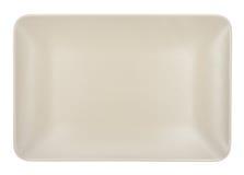Placa rectangular beige aislada en el fondo blanco Imagen de archivo