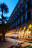 Placa Reial with  restaurants in evening. Barcelona Royalty Free Stock Photography