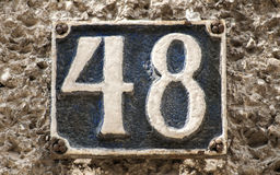 Placa retro velha número 48 do ferro fundido Imagem de Stock