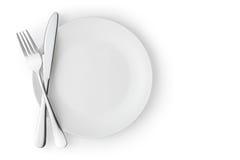 Placa vacía con la fork y el cuchillo Imagen de archivo libre de regalías