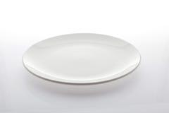 Placa vacía de la comida aislada en el fondo blanco Fotografía de archivo libre de regalías