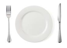 Placa vacía con la fork y el cuchillo Imagen de archivo
