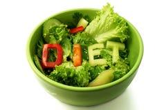 Placa verde con la dieta de la palabra integrada por rebanadas Imagen de archivo