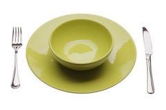 Placa verde con los tablewares Fotografía de archivo
