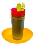 Placa, vidros, colher e forquilha plásticos Imagem de Stock Royalty Free