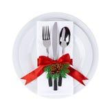 Placa y cubiertos de la Navidad aislados en el fondo blanco Foto de archivo libre de regalías
