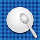 Placa y cuchara Foto de archivo libre de regalías