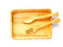 Placa y cuchara de madera Imagen de archivo