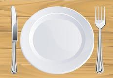 Placa y cuchillería en el vector de madera Fotos de archivo libres de regalías