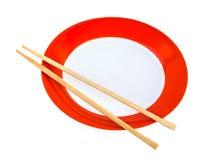 Placa y palillos Imagen de archivo libre de regalías