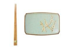 Placa y palillos japoneses Foto de archivo libre de regalías