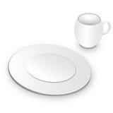 Placa y taza blancas Imagenes de archivo