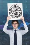 Placard with drawing brain. Businessman holding placard with drawing brain Royalty Free Stock Photos