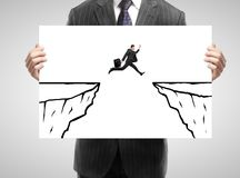 Placard with man jump mountain Royalty Free Stock Image