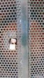 Placard Padlocked en métal avec les trous ronds de coupe-circuit photographie stock libre de droits