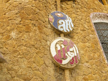 Placard of Park Guell designed by Antonio Gaudi stock images