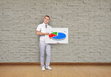 Placard with pie chart. Businessman holding placard with business pie chart Stock Photos
