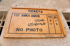Placard in Tut Ankh Amon tomb. Wooden placard with rates, tickets and no photo, in Egyptian Tut Ankh Amon tomb, or Tutankhamun, in landmark Kings Valley, in Royalty Free Stock Photos