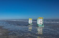 Signs installed on the beach. Placards are set up for beach safety, Daytona Beach, Florida, U.S.A Stock Image