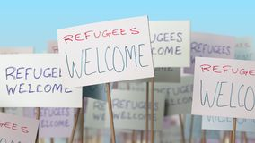 REFUGEES WELCOME placards at street demonstration. Conceptual loopable animation. Placards at street demonstration. Loopable animation stock footage
