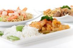 Placas con las comidas orientales Foto de archivo libre de regalías