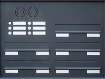Placas de identificação das caixas postais e botões de sino imagem de stock