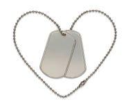 Placas de identificación militares del corazón imagen de archivo