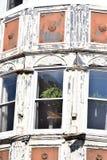 Placas de janela de vidro do vintage no quadro de madeira Fotografia de Stock