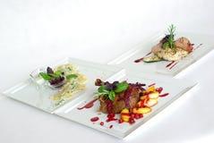 Placas de la comida de cena fina Imagen de archivo