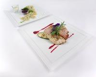 Placas de la comida de cena fina Fotos de archivo
