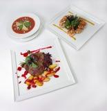 Placas de la comida de cena fina Imágenes de archivo libres de regalías