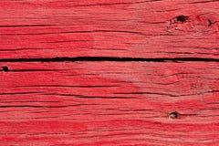 Placas de madeira rachadas idosas pintadas vermelhas Foto de Stock Royalty Free