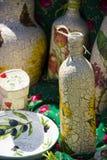 Placas decorativas y otra de la botella Imágenes de archivo libres de regalías