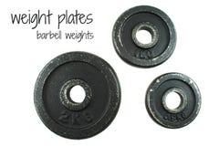Placas del peso aisladas en el fondo blanco Foto de archivo libre de regalías