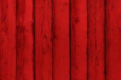 Placas, parede ou cerca vermelha pintada de madeira natural connosco Fundo textured sumário, molde vazio Pranchas de madeira pint Fotografia de Stock