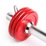 Placas rojas de la pesa de gimnasia Fotografía de archivo libre de regalías