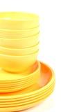 Placas y cuencos amarillos Imágenes de archivo libres de regalías