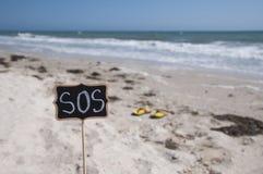 Placca di legno con un'iscrizione SOS Fotografia Stock Libera da Diritti