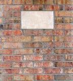 Placca in un muro di mattoni Fotografie Stock Libere da Diritti