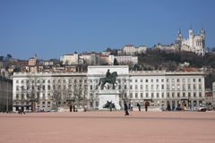 Place Bellecour. The main place in Lyon city center, the Place Bellecour is toped by hill and Basilique of Fourviere Stock Photos