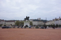 Place Bellecour with equestrian statue of Louis XIV  in Lyon. LYON, FRANCE - OCTOBER 8: Place Bellecour with equestrian statue of Louis XIV  in Lyon on October 8 Stock Photos