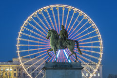Place Bellecour, famous statue of King Louis XIV and the wheel. Place Bellecour statue of King Louis XIV by night, Lyon France Stock Photo