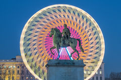 Place Bellecour statue of King Louis XIV by night. Lyon France Stock Photos