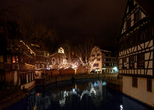 Place Benjamin Zix Christmas market stalls reflected in Ill rive Stock Images