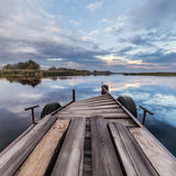 Place for boat on amazing sky background. Wooden Place for boat on amazing sky background Stock Photos