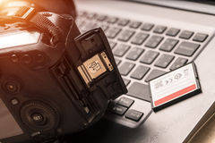 Place the camera on a notebook, camera card. Royalty Free Stock Photography
