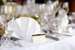Place card on the white festive table. Empty place card on the white festive table Royalty Free Stock Images