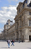 Place Carrousel, Louvre. Tourists walk and take pictures Stock Images