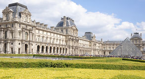 Place Carrousel, Louvre. Tourists walk and take pictures Royalty Free Stock Photos
